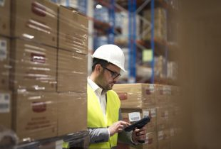 Working at large warehouse facility controlling goods distribution.
